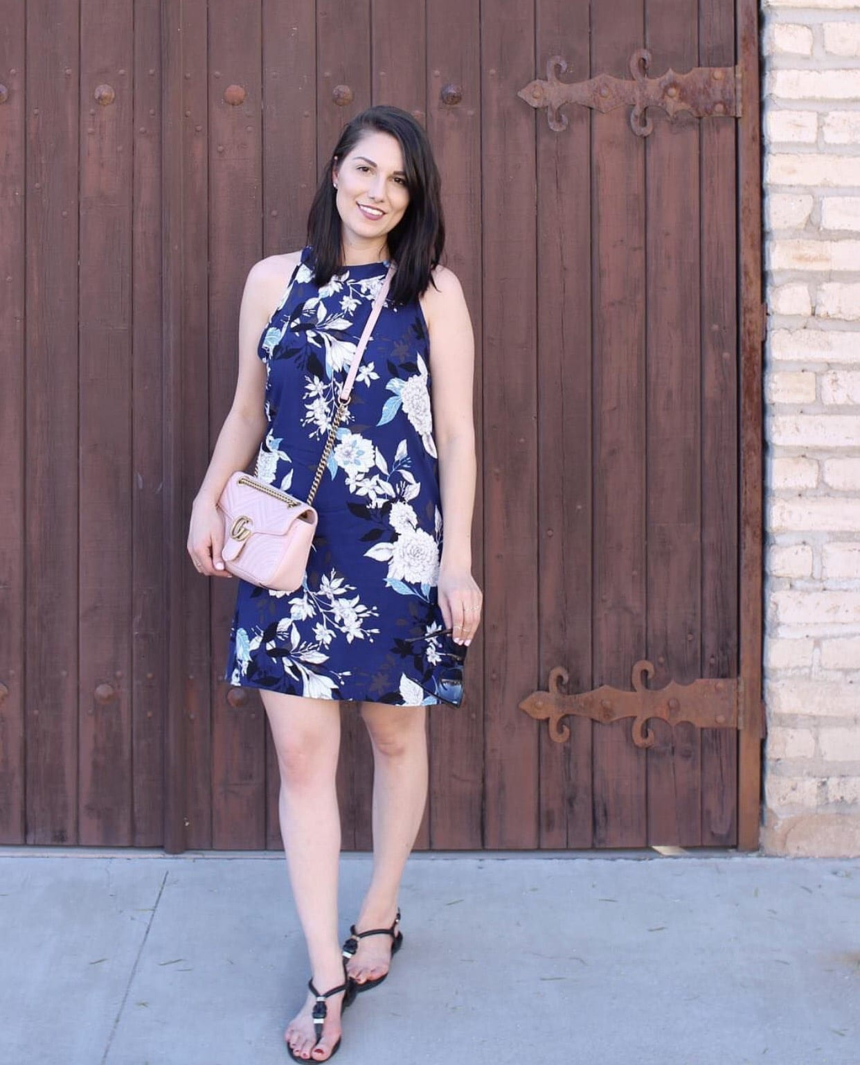 This is a close up of me wearing a blue floral dress from Stitchfix in Barrio Viejo, Tucson.