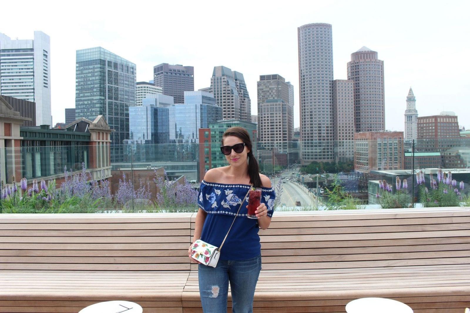 This is me at the rooftop terrace bar at YOTEL Boston.