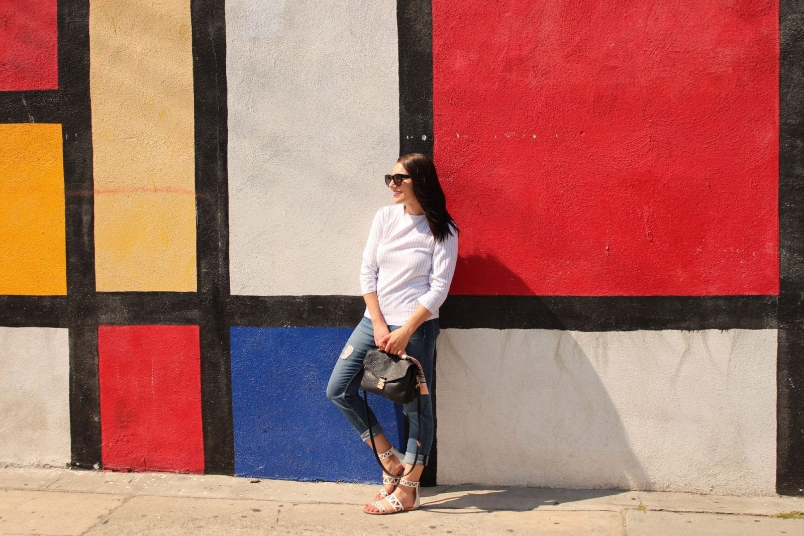 This is a photo of me standing facing the right in front of the Mondrian Wall in Los Angeles.