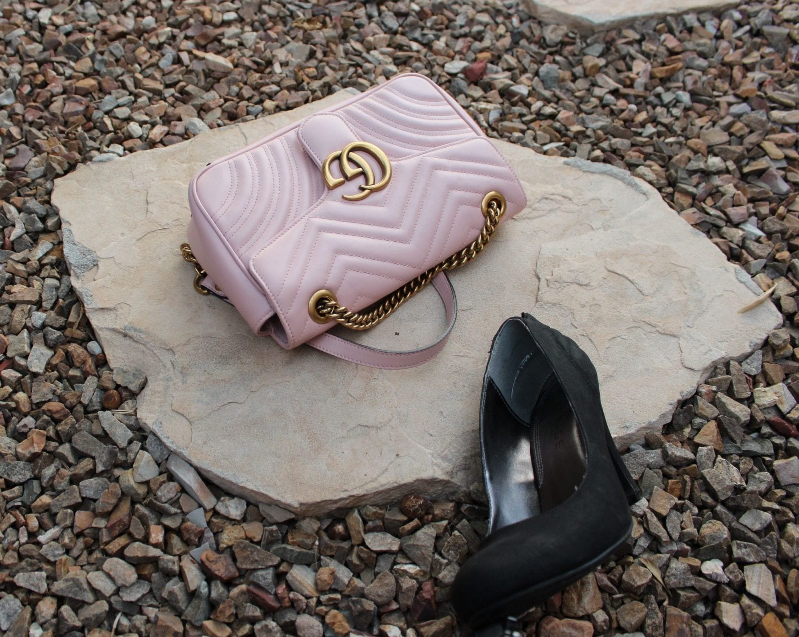 This is a close up of a black heel and my Gucci Marmont bag.