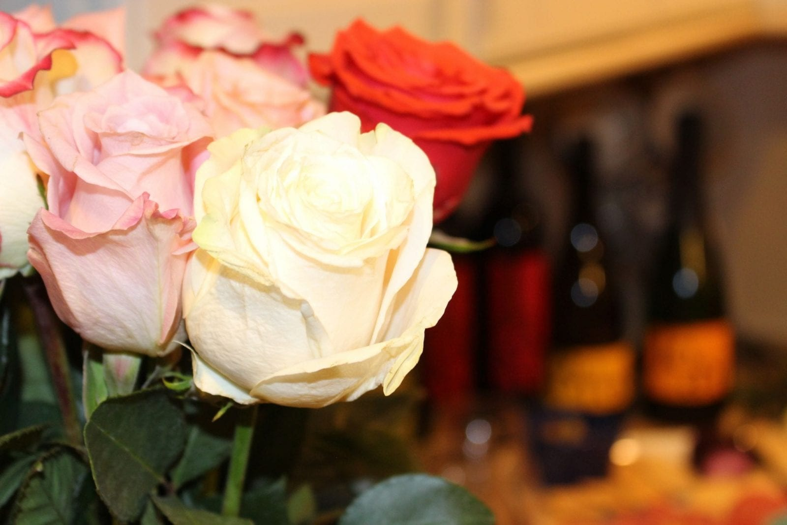 This is a close up of the roses, with the JaM Cellars wine in the background.