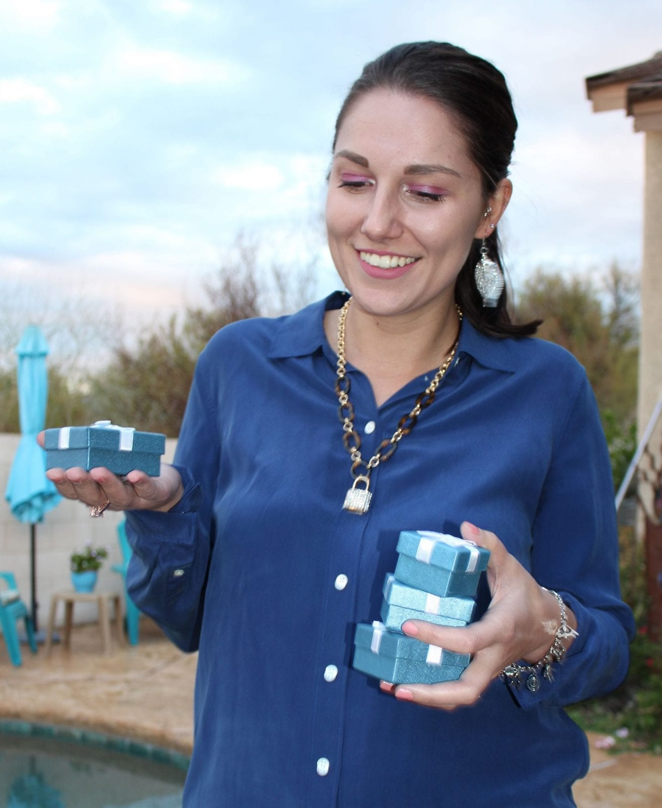 This is a close up of me holding the blue boxes from Shop LC.