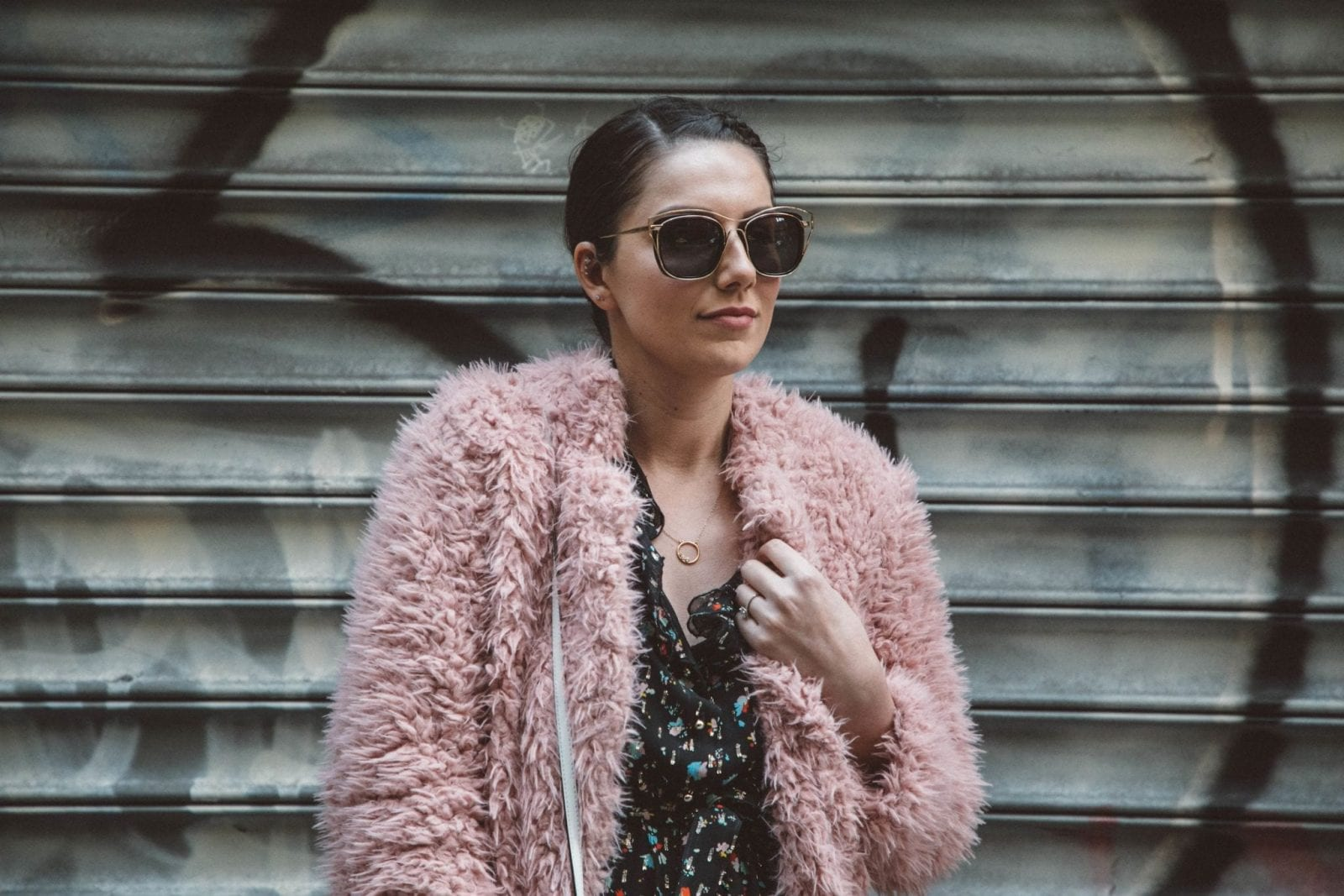 This is a close up shot of me wearing a pink fluffy coat from Amazon Fashion in New York CIty.