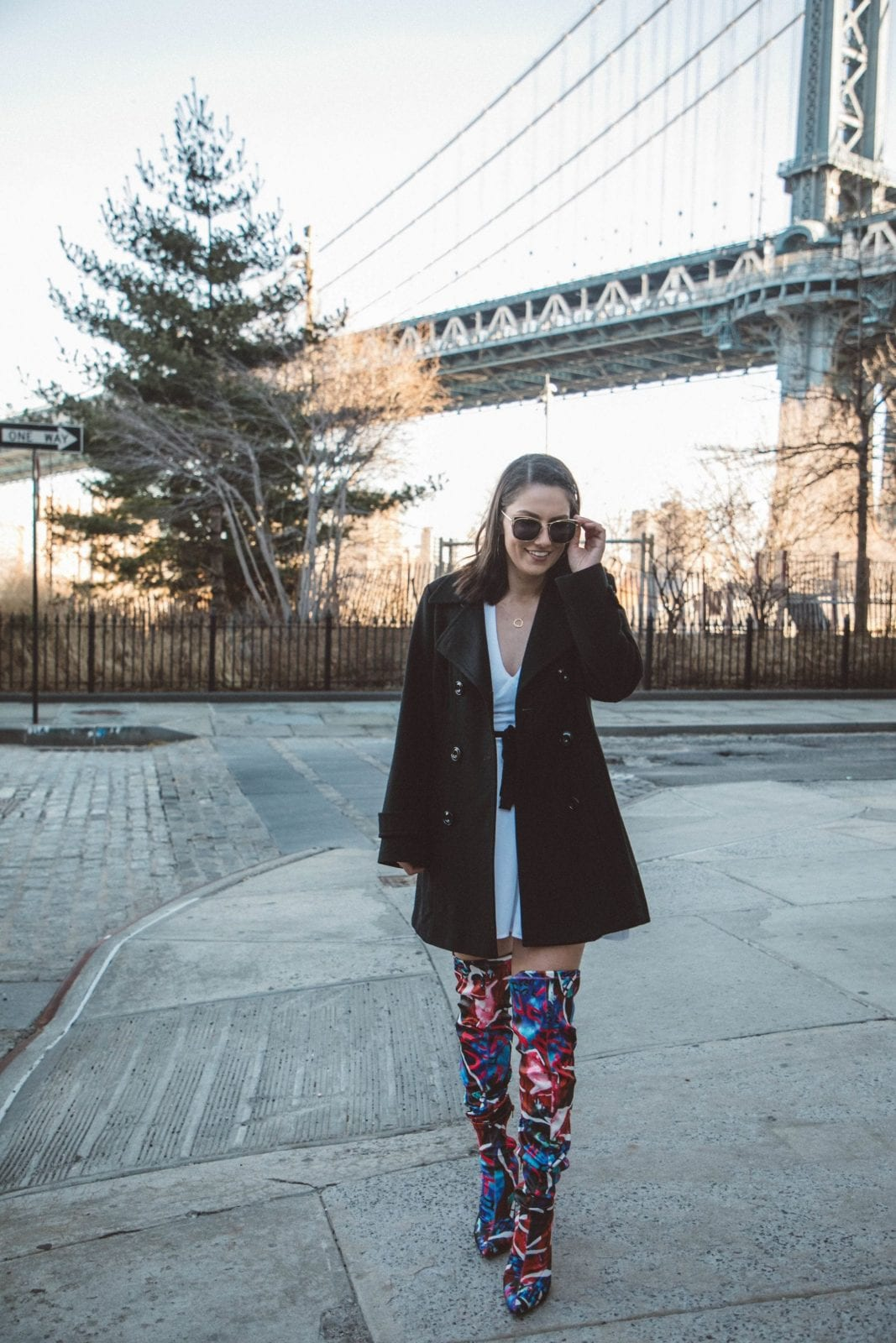 This is a photo of me standing outside in Dumbo, Brooklyn in my nighttime look.