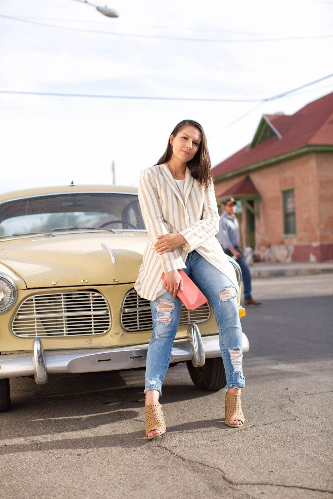This is a photo of me wearing Chriselle x JOA while sitting on an old school Volvo in Tucson Arizona.