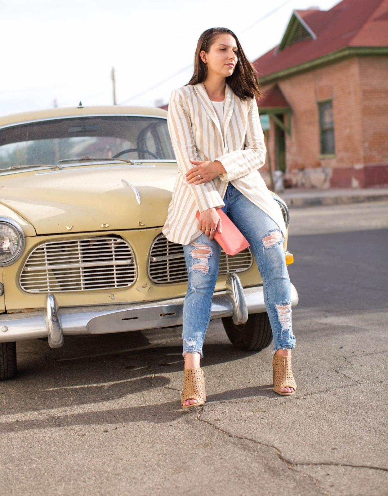 This is a close up of me sitting on top of an old school Volvo in Barrio Viejo rocking a JOA blazer from Nordstrom.