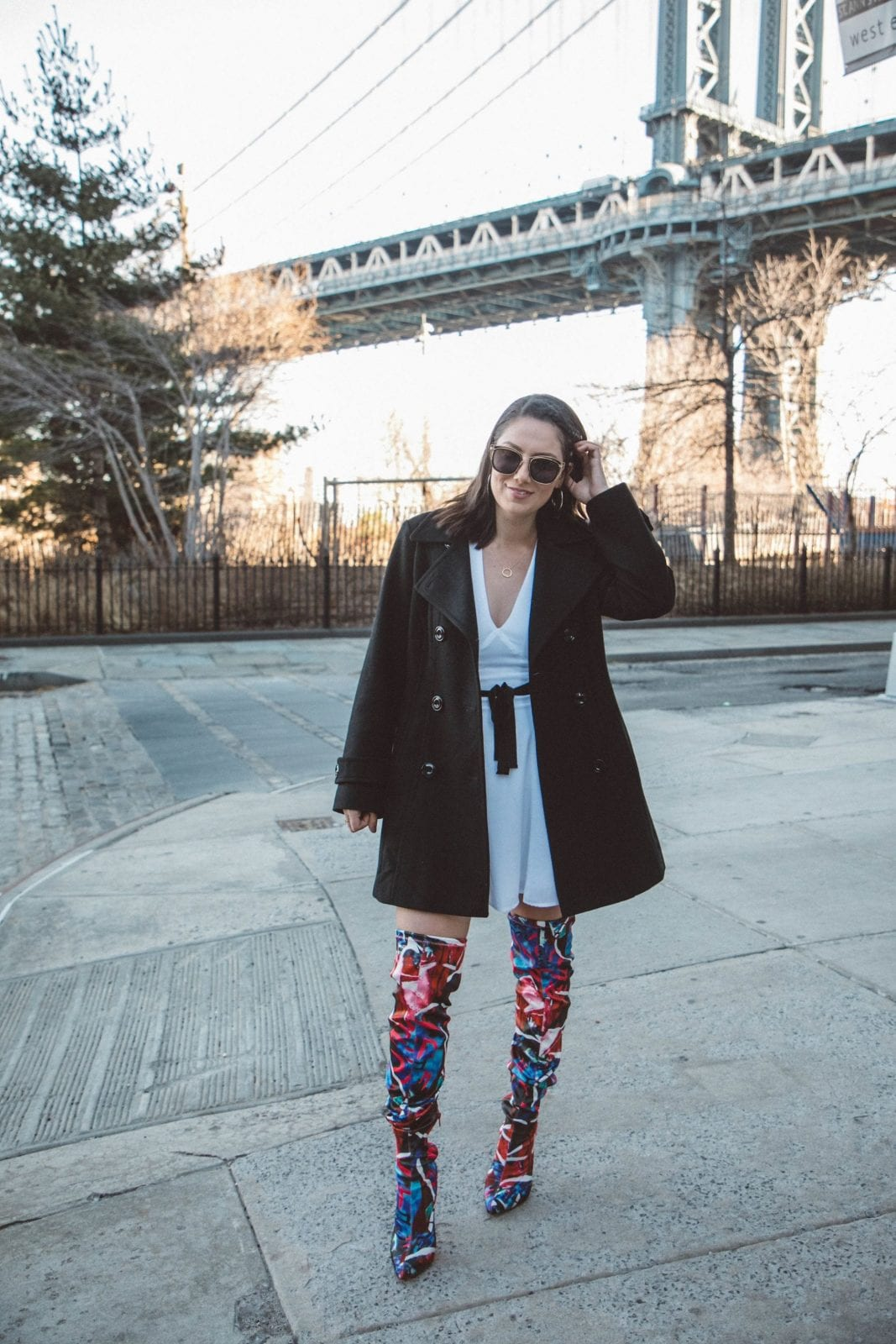This is a photo of me standing outside in Dumbo, Brooklyn in my nighttime outfit.