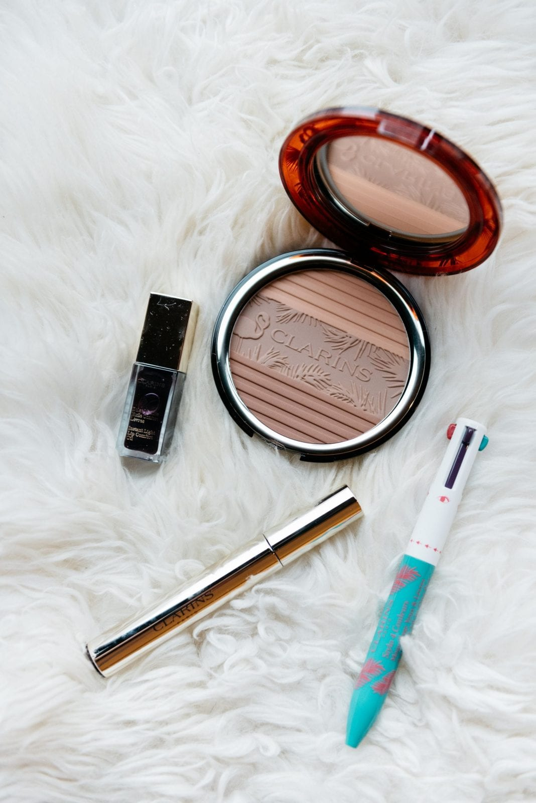 This is a photo of the Clarins Summer Collection including the bronzer, mascara, lip oil and eye pen.