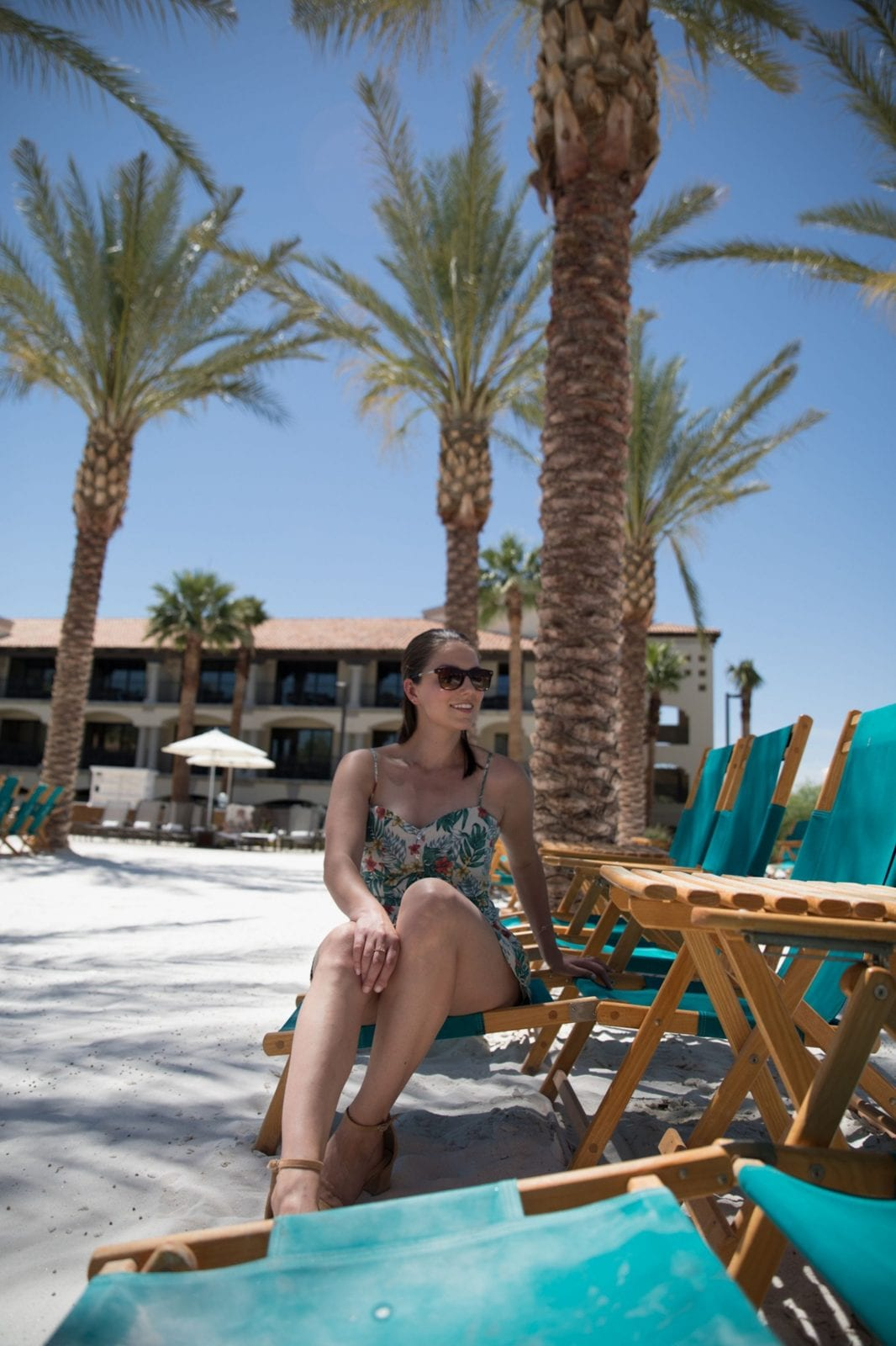 This is a photo of me sitting at the beach pool at the Scottsdale Fairmont Princess, showcasing a gorgeous summer dress.