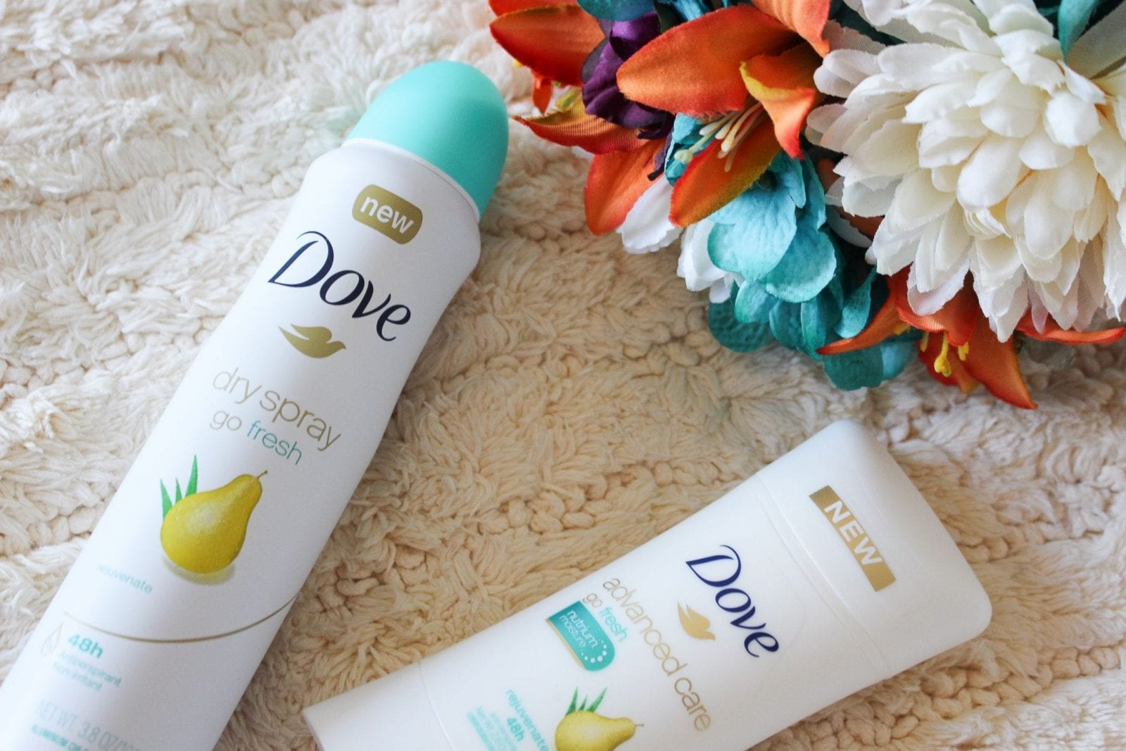 This is a close up of the new Dove Pear & Aloe Versa Antiperspirant and Dry Spray.