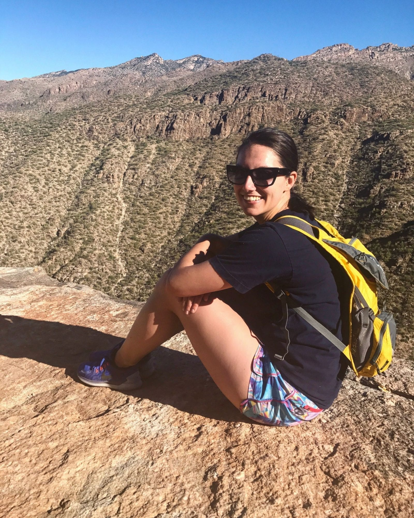 This is a close up shot of me sitting at the top of Sabino Canyon in Tucson Arizona.