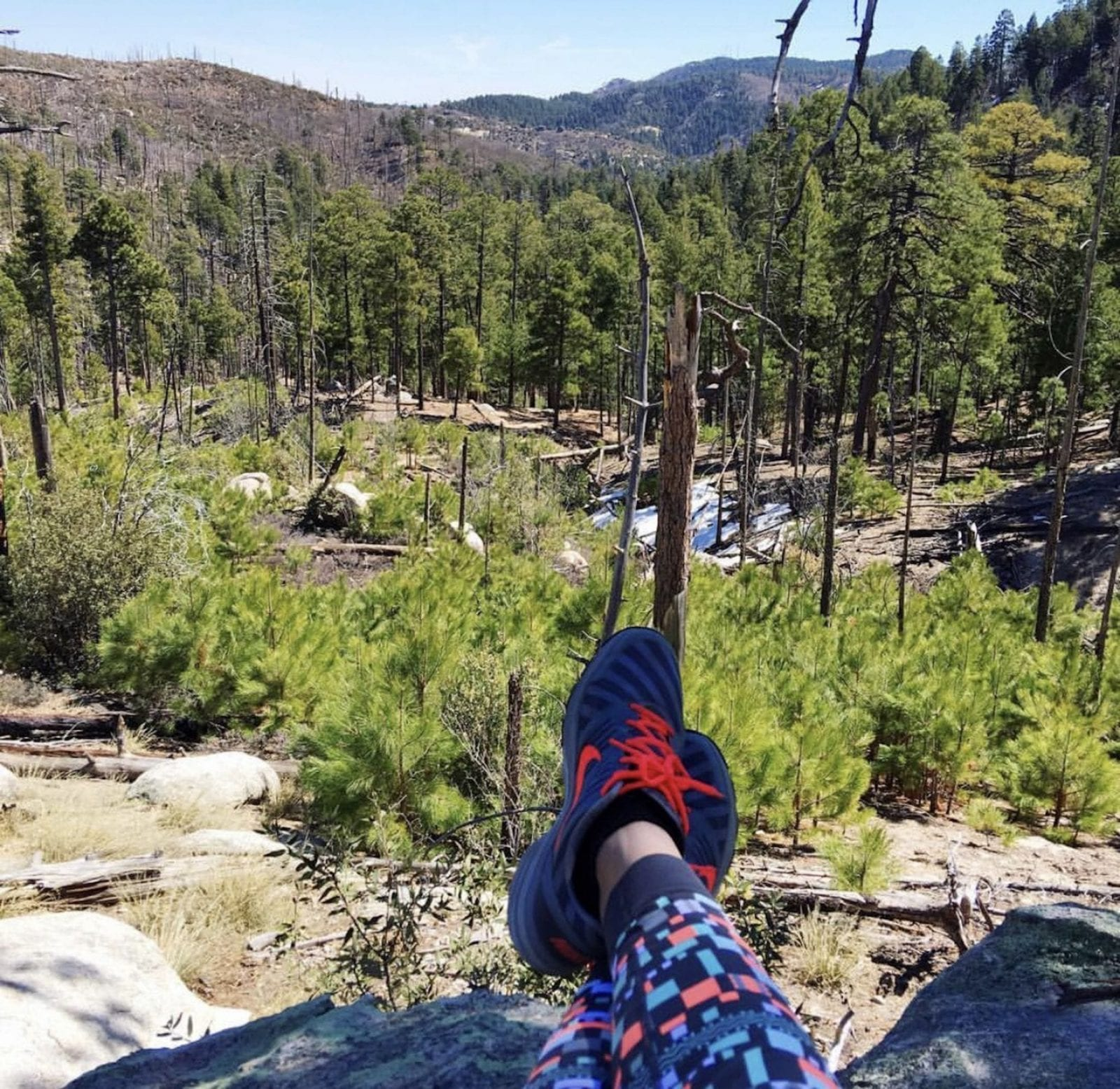 This is a close up of my Nike running shoes with a view of Mount Lemmon, after hiking.