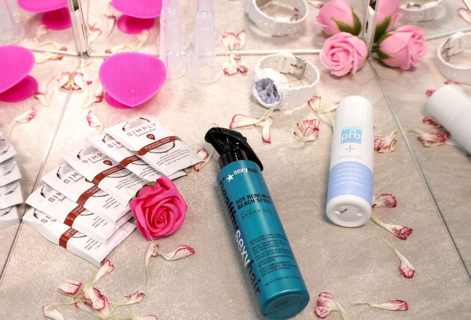 This is a flat lay featuring all the products in the Hot Weather Beauty Hacks Babbleboxx.