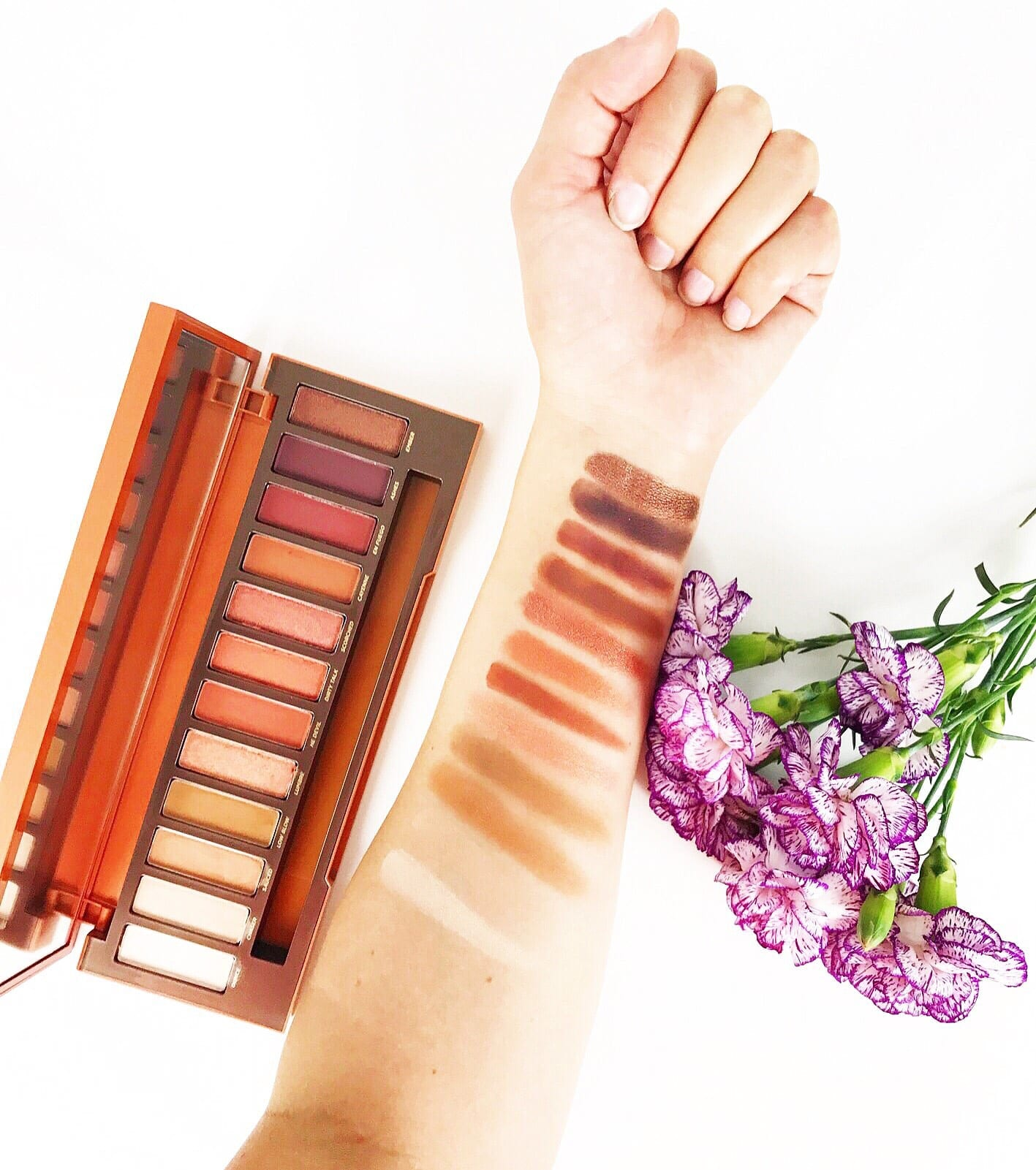 This is a photo of the swatches from the new Urban Decay Naked HEAT Palette