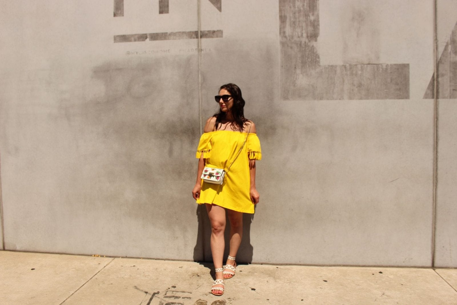 This is a close up of me wearing a bright yellow summer dress from ASOS in Los Angeles.