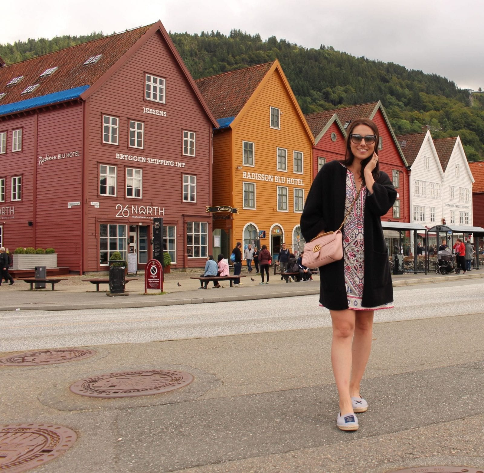 I'm enjoying the Bryygen view in Bergen Norway, while rocking a Hale Bob dress.