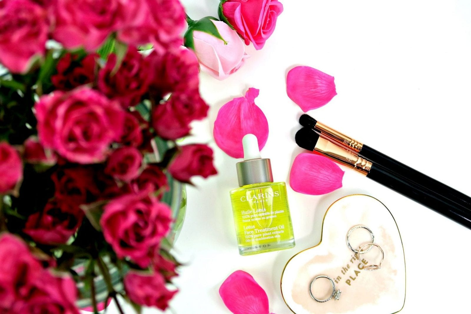 This is a flat lay shot of my pink roses, Clarins Lotus Oil and some other gorgeous details.