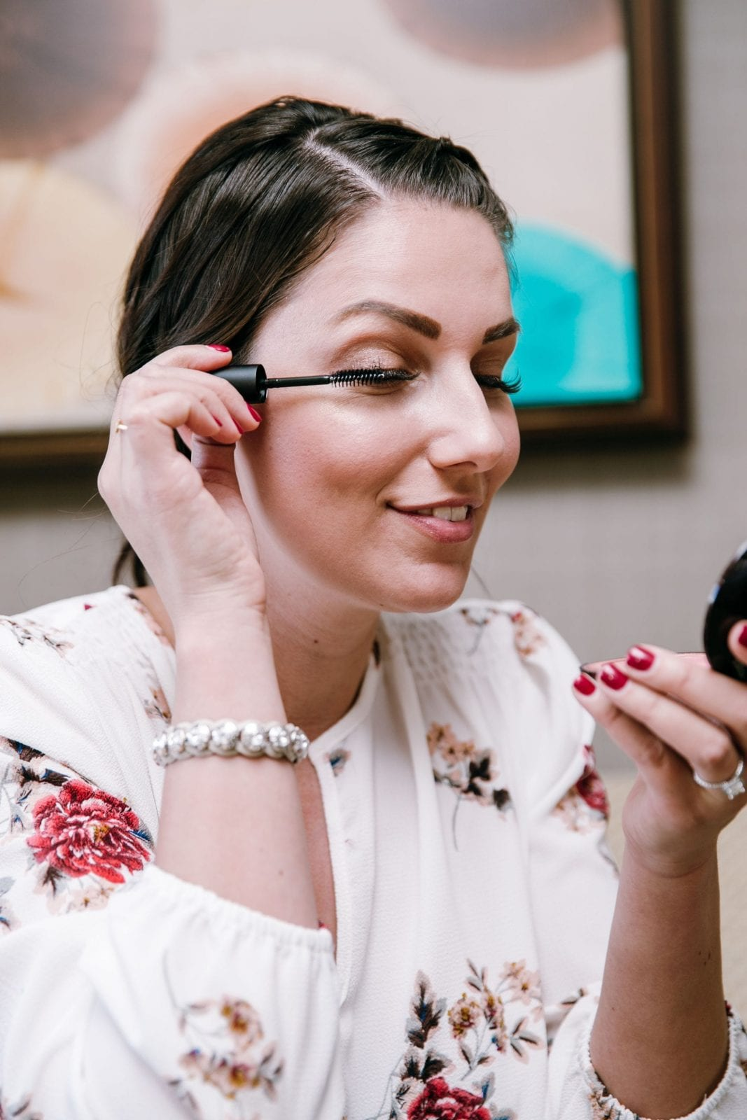 This is a close up of me applying the mascara to my lash extensions from Amazing Lash Studio.