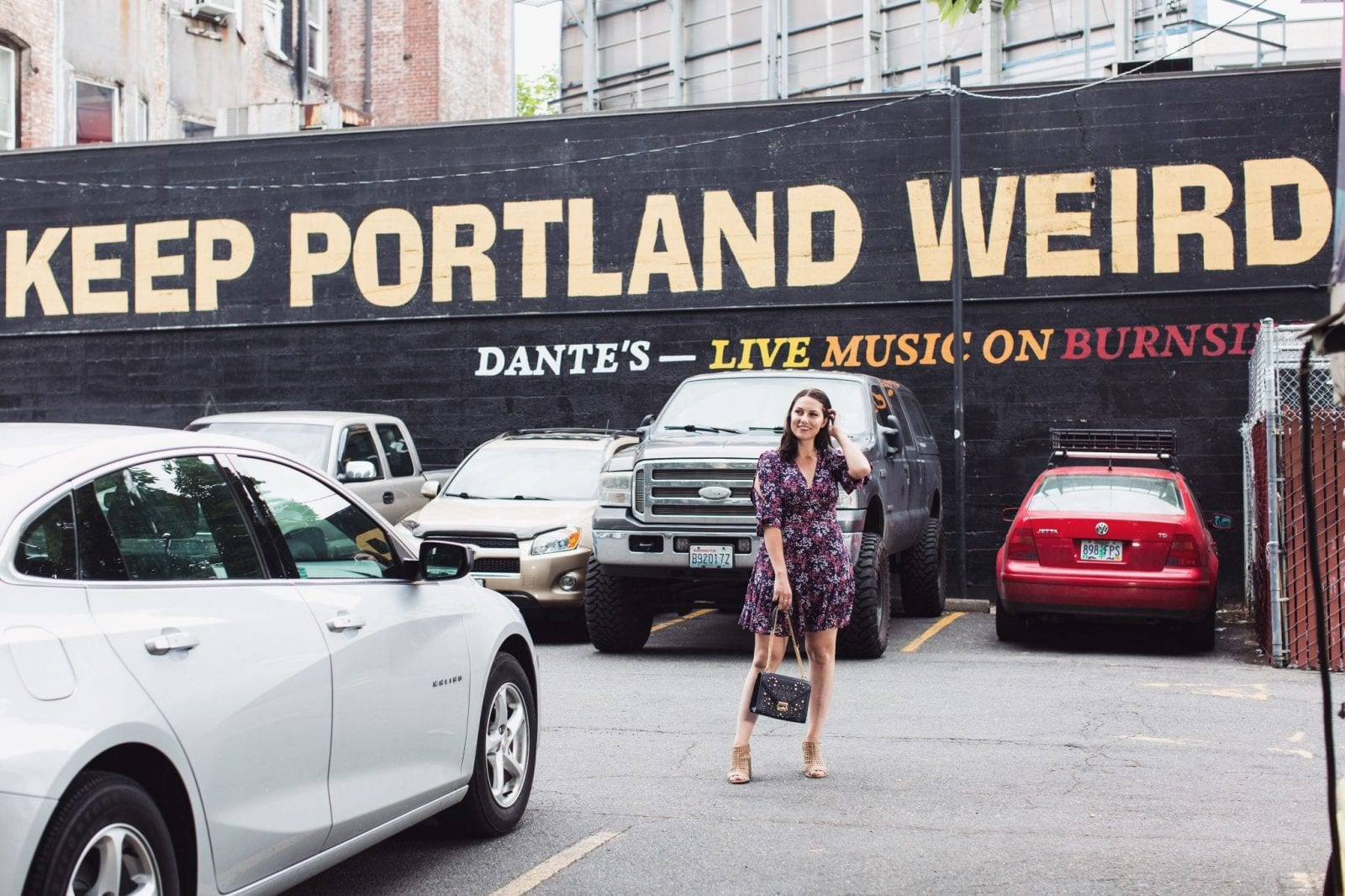 "This is a fun shot of me standing in front of the ""Keep Portland Weird"" mural in Portland, Oregon."
