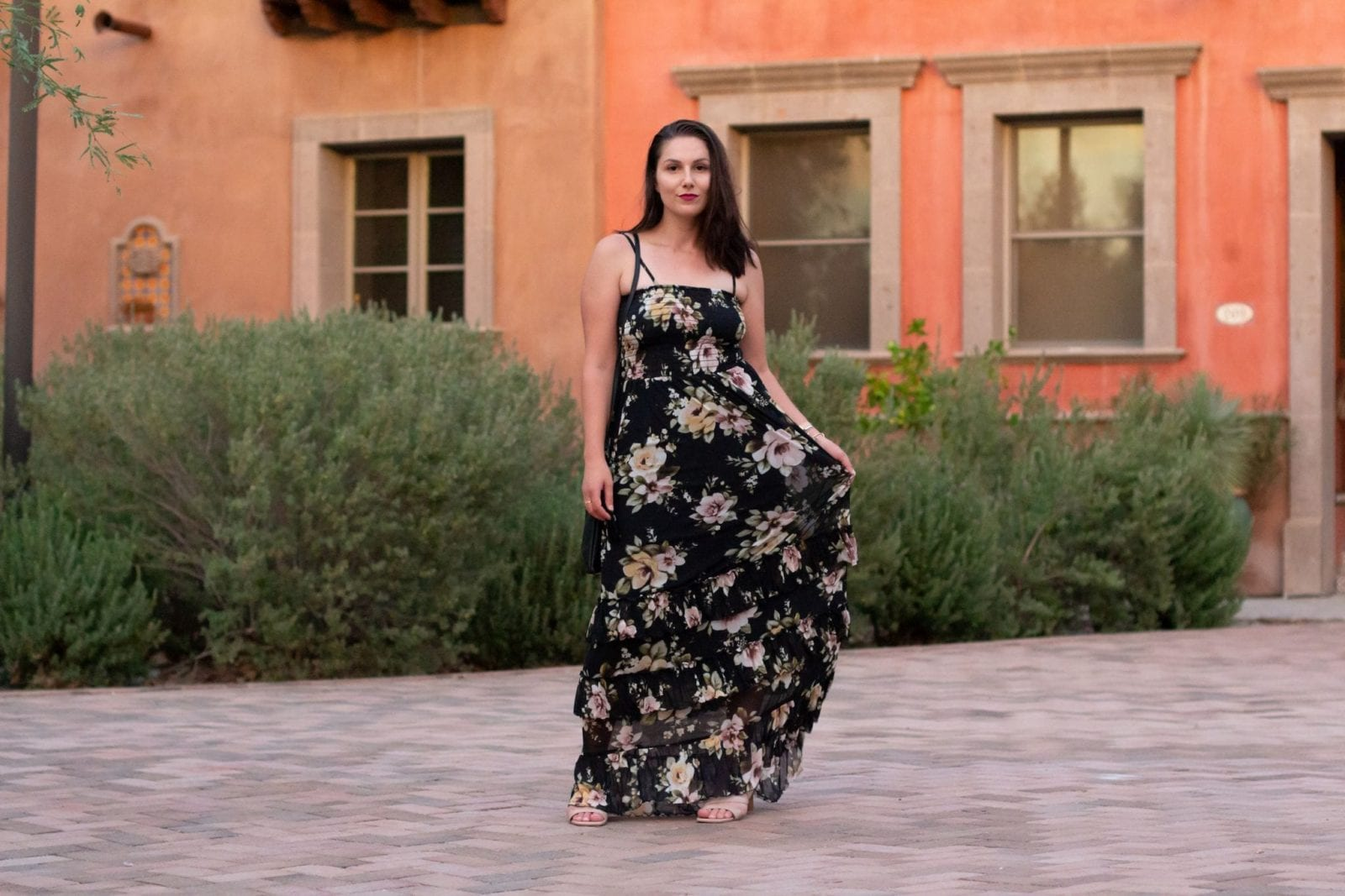 This is a full body shot of me standing at San Mercado Agustin in a black floral maxi dress.