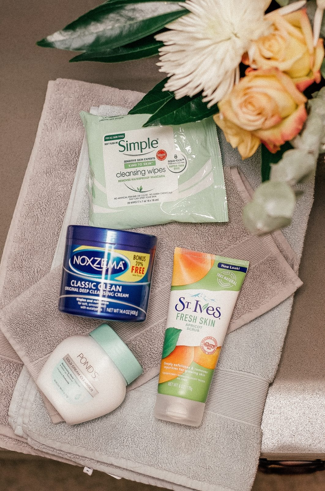 This is a flat lay shot of the entire Walmart skincare routine featuring Noxzema, St. Ives, Ponds and Simple.