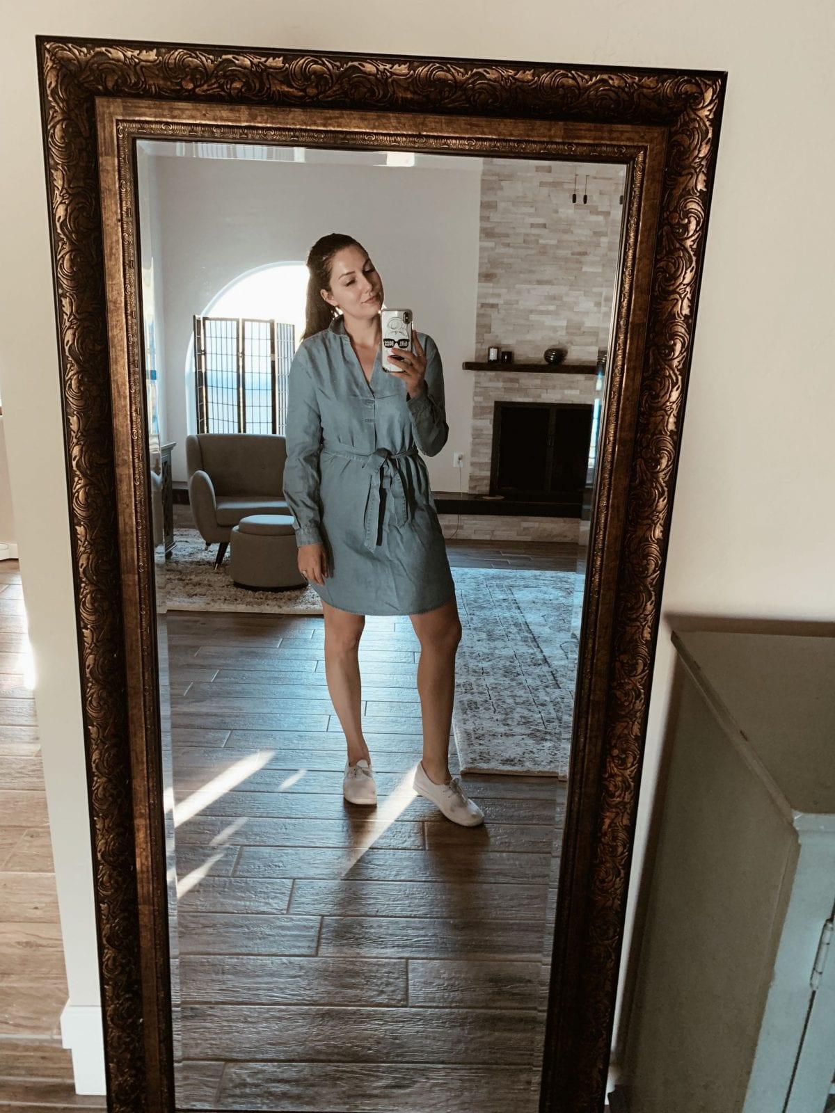 Taking a mirror selfie rocking the denim dress.
