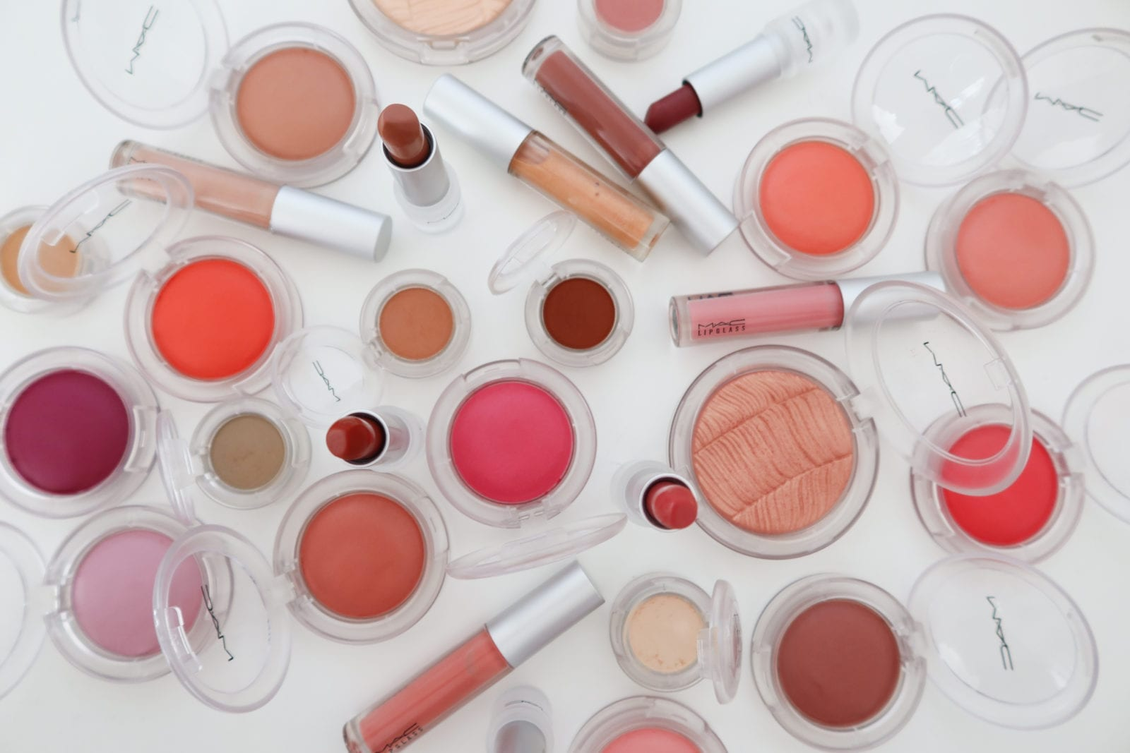 This is a flat lay of the new MAC Cosmetics Loud and Clear Collection, along with the Glow Play Blush.