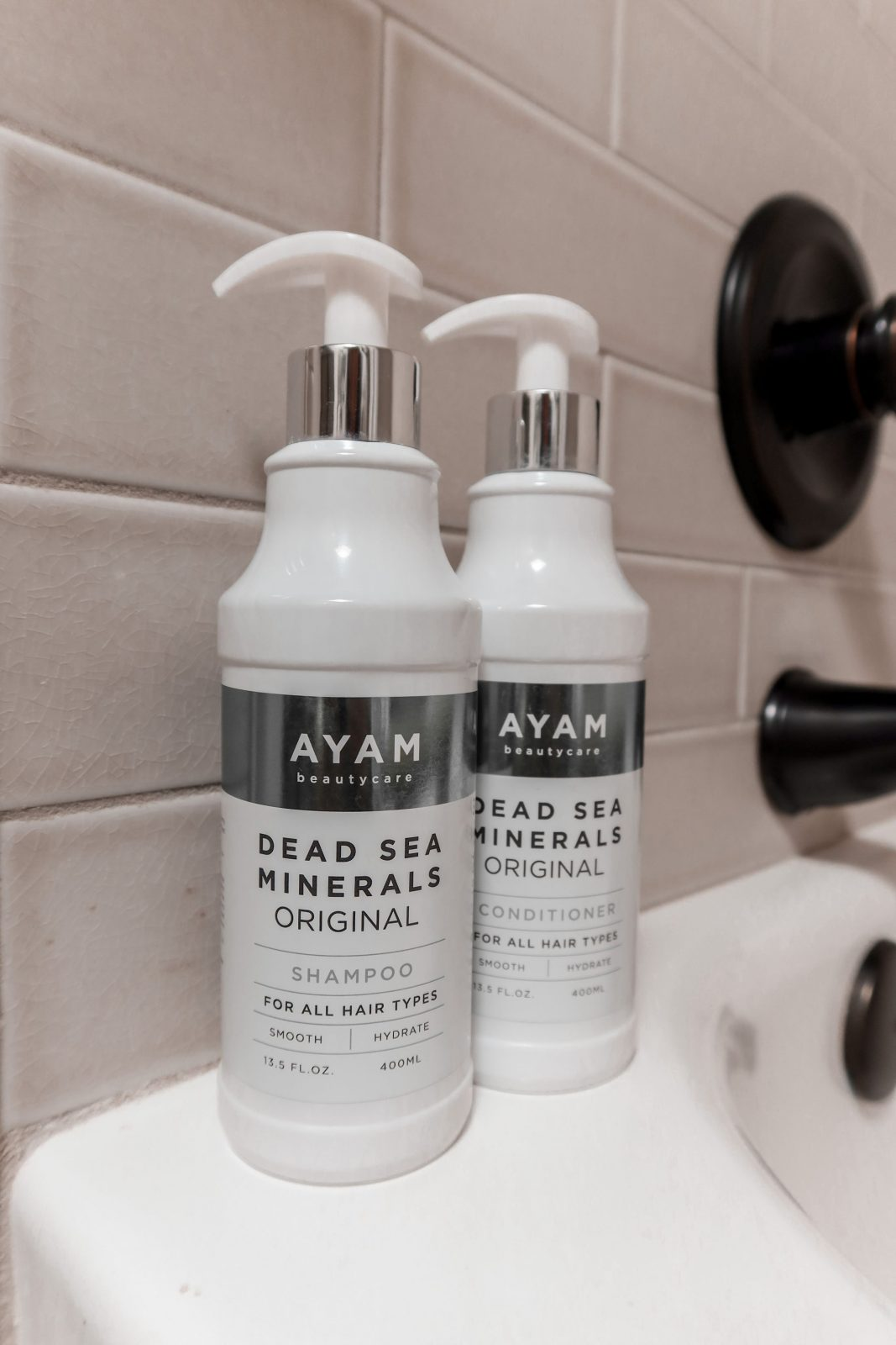 This is a close up of Ayam Beautycare shampoo and conditioner in Adaleta's bathroom.