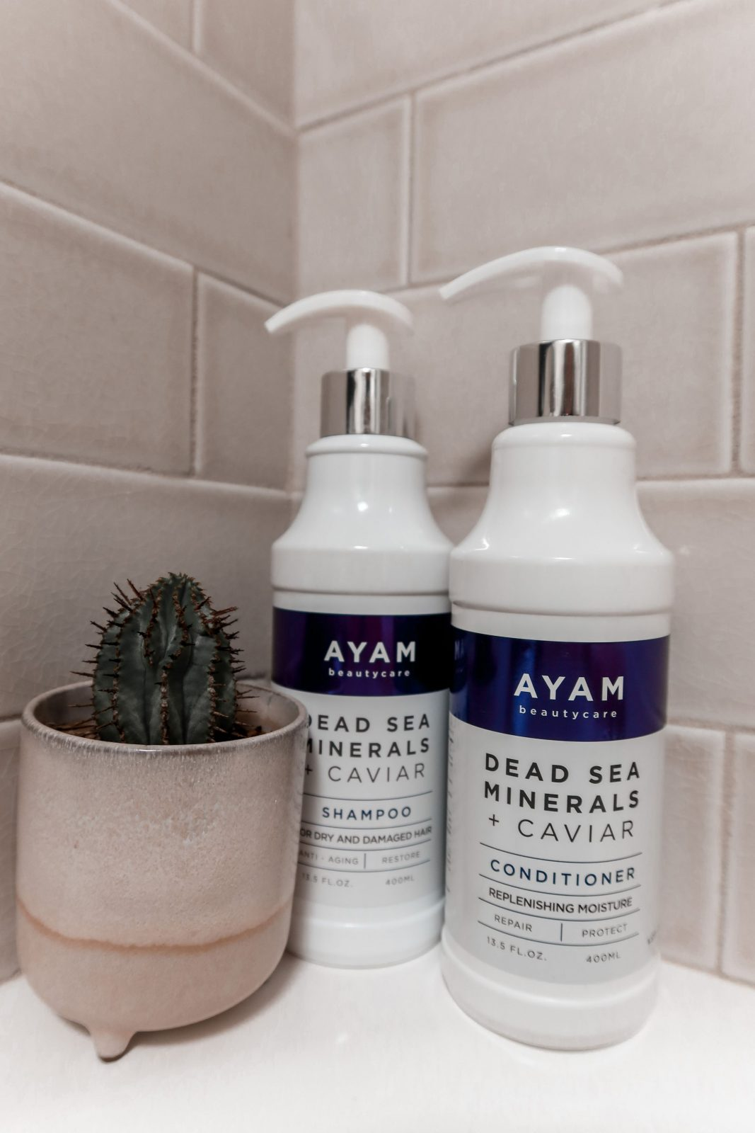 This is a close up of Ayam Beautycare Dead Sea & Caviar shampoo and conditioner in Adaleta's bathroom.